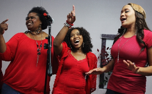 From left, Sheridan Wallace, Ray Chelle Williams and Melissa Bolden sing as The Friends of Gospel choir rehearses.