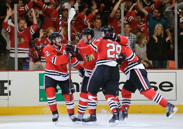 The Chicago Blackhawks celebrate after a goal against the Los Angeles Kings during the second period of Game 1 of the NHL hockey Stanley Cup Western Conference finals on Saturday in Chicago.