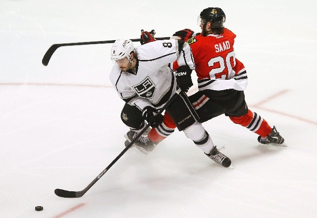 Los Angeles Kings defenseman Drew Doughty (8) gets tangled up with Chicago Blackhawks left wing Brandon Saad (20) during the third period in Game 1 of the NHL hockey Stanley Cup Western Conference ...