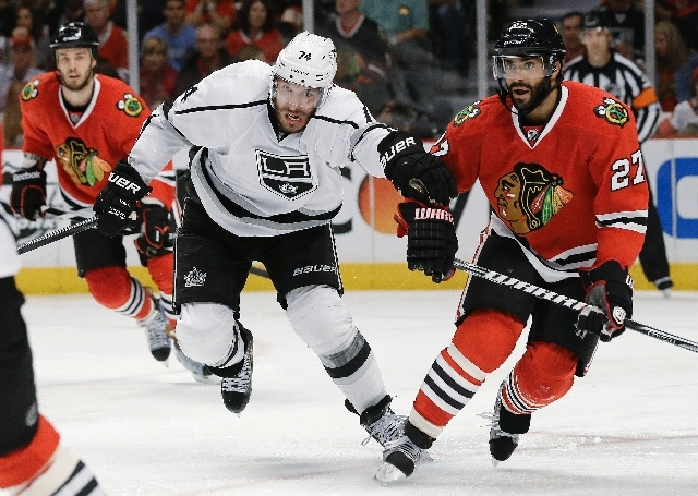 Los Angeles Kings center Dwight King (74) races up the ice against Chicago Blackhawks defenseman Johnny Oduya (27) during the third period of Game 1 of the NHL hockey Stanley Cup Western Conferenc ...