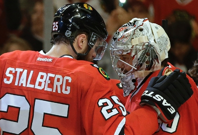 Chicago Blackhawks left wing Viktor Stalberg (25) congratulates goalie Corey Crawford after Crawford held the Los Angeles Kings to one goal Game 1 of the NHL hockey Stanley Cup Western Conference  ...
