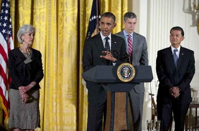 President Barack Obama, accompanied by, from left, Health and Human Services Secretary Kathleen Sebelius, Education Secretary Arne Duncan, and Veterans Affairs Secretary Eric Shinseki, gestures wh ...