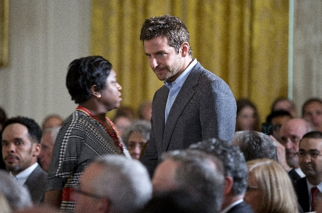 Actor Bradley Cooper arrives in the East Room of the White House in Washington on Monday for the White House mental health conference.