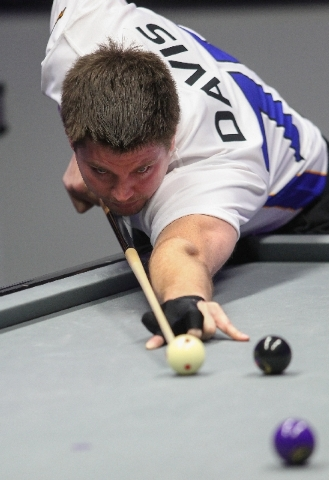 Las Vegas' Mike Davis lines up a shot against Toronto during a World Professional Billiard League game at the WPBL Arena, 6745 Surrey St., in Las Vegas on Sunday.