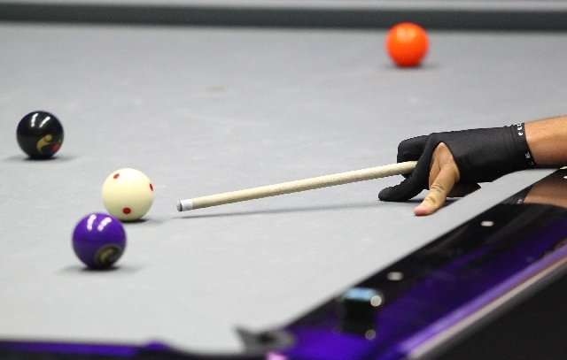 Las Vegas' John Schmidt lines up a shot against Toronto during a World Professional Billiard League game at the WPBL Arena, 6745 Surrey St., in Las Vegas on Sunday.