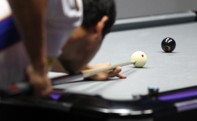 Las Vegas' Charlie Williams lines up a shot against Toronto during a World Professional Billiard League game at the WPBL Arena, 6745 Surrey St., in Las Vegas on Sunday.