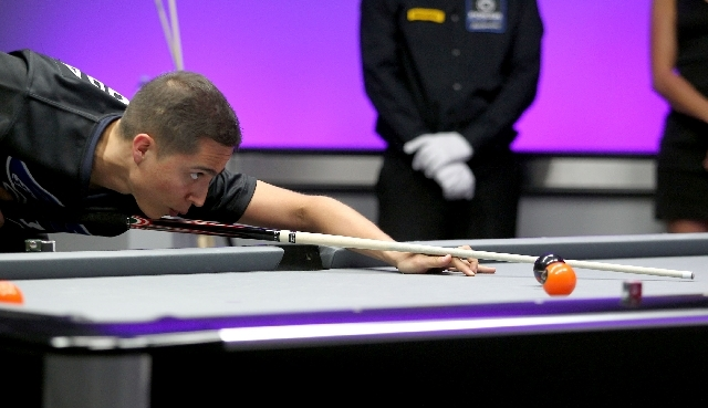 Toronto's John Morra lines up a shot against Las Vegas during a World Professional Billiard League game at the WPBL Arena, 6745 Surrey St., in Las Vegas on Sunday.