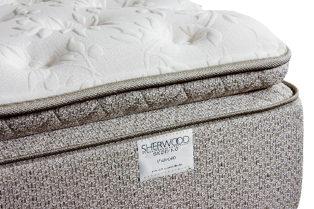 With a pillowtop and luxurious, patterned ticking, the exterior of a Sherwood Bedding hybrid mattress looks comfortable. Experts, however, recommend lying on the bed for at least five minutes to t ...