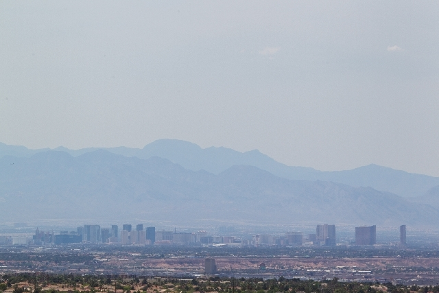 Wildfires in nearby Lovell Canyon and in Southern California blanketed the sky over the Las Vegas Valley on Monday with a haze.