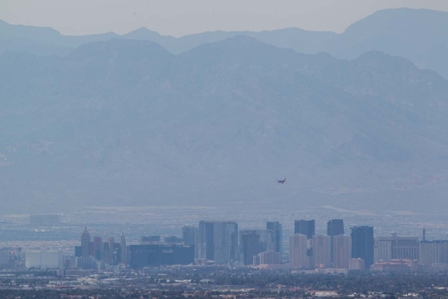 Smoke and haze from wildfires in nearby Lovell Canyon and in Southern California cover the Las Vegas Valley on Monday. An air quality advisory was issued effective through Tuesday.