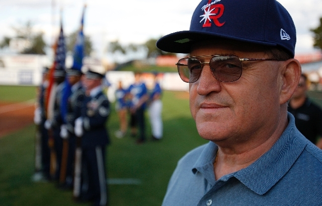Retired Lt. Col. Bill Anton stands on the diamond at Cashman Field before throwing out the first pitch before the start of the baseball game between the Las Vegas 51s and the Tacoma Rainiers at Ca ...