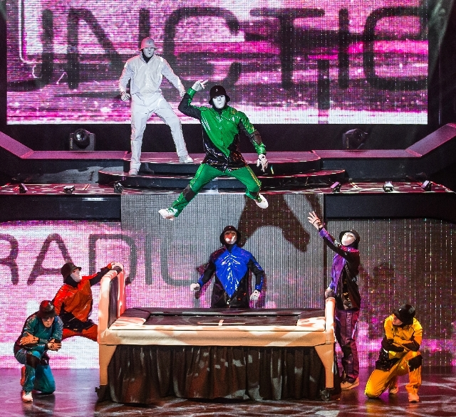"The Jabbawockeez perform in color-coded costumes in their new Luxor show ""Prism."""
