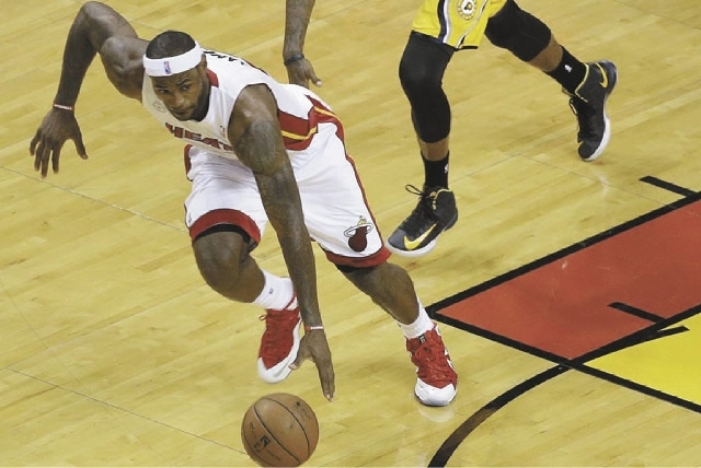 Miami Heat small forward LeBron James dribbles the ball during Game 7 in their NBA basketball Eastern Conference finals playoff series against the Indiana Pacers, Monday, June 3, 2013 in Miami.