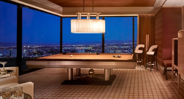 A pool table is one of the features in this three-bedroom suite at the Encore Hotel-Casino in Las Vegas, shown in this undated handout photo.