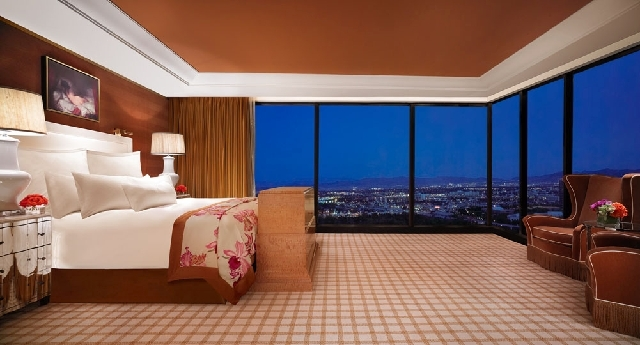 This undated handout photo of a three-bedroom suite at the Encore Hotel-Casino in Las Vegas shows a bedroom with a floor-to-ceiling view. A California lawyer has been sued after a 45th birthday ce ...