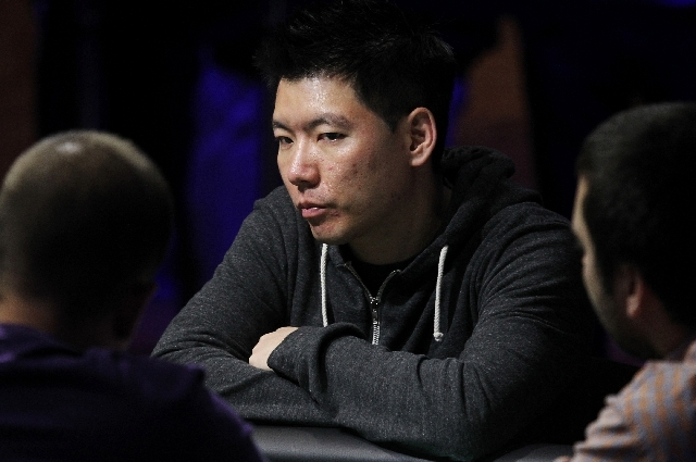 Benny Chen checks out his competition during the World Series of Poker's Millionaire Maker final table at the Rio in Las Vegas on Tuesday. Chen emerged from a field of 6,343 players to win the nea ...