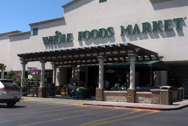 A Whole Foods Market in Albuquerque, N.M., is shown Thursday during lunch time. Two employees at this Albuquerque store say they were suspended last month after complaining about being told they c ...