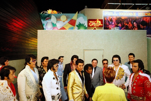 Elvis impersonators listen to instructions backstage May 10.