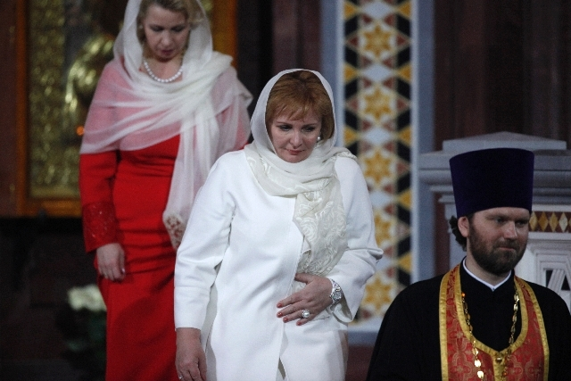 Russian President Dmitry Medvedev's wife Svetlana, left, and Prime Minister Vladimir Putin's wife Lyudmila, center, leave an Easter service in the Christ the Savior Cathedral in Moscow, Russia on  ...