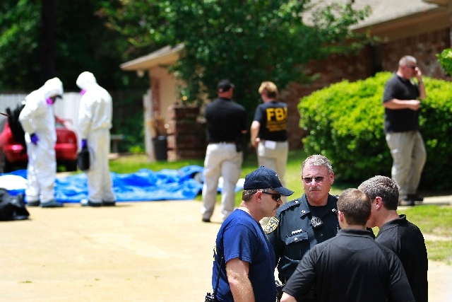 Authorities search a residence in New Boston, Texas in connection with a federal investigation surrounding ricin-laced letters mailed to President Barack Obama and New York Mayor Michael Bloomberg.