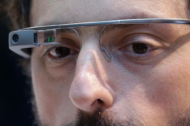 Google co-founder Sergey Brin wears a Google Glass device in San Francisco on Feb. 20. Casinos in several states, including Nevada, are forbidding gamblers from wearing the tiny eyeglasses-mounted ...