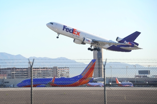 A FedEx cargo plane takes off from McCarran International Airport on Friday.