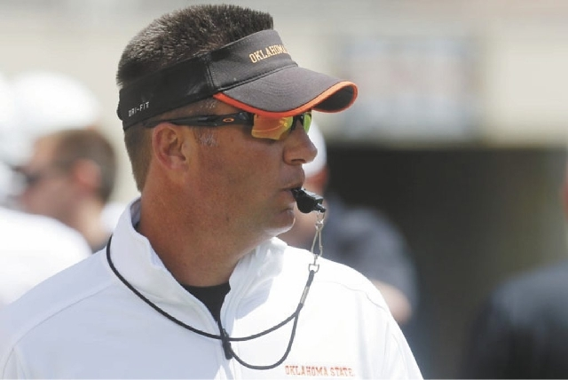 Oklahoma State head coach Mike Gundy watches during the Oklahoma State spring NCAA college football game in Stillwater, Okla., Saturday, April 20, 2013.