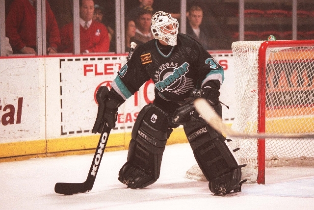 Clint Malarchuk is shown in 1996 playing goalie for the Las Vegas Thunder of the International Hockey League. Malarchuk, the subject of a new mini-documentary on ESPN.com, played four seasons for  ...