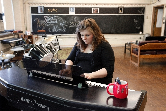 Carole Hoste, plays piano on June 5, 2013 at the Detroit School of Music, a former Detroit Public School building, where she gives private music lessons in Detroit.