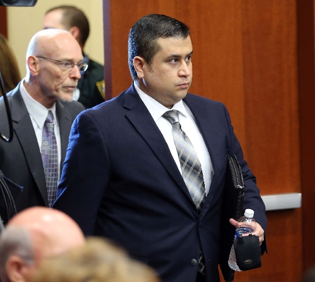 George Zimmerman arrives in circuit court for his trial, along with co-counsel Don West, Monday in Sanford, Fla. Zimmerman is charged in the fatal shooting of unarmed teenager Trayvon Martin.