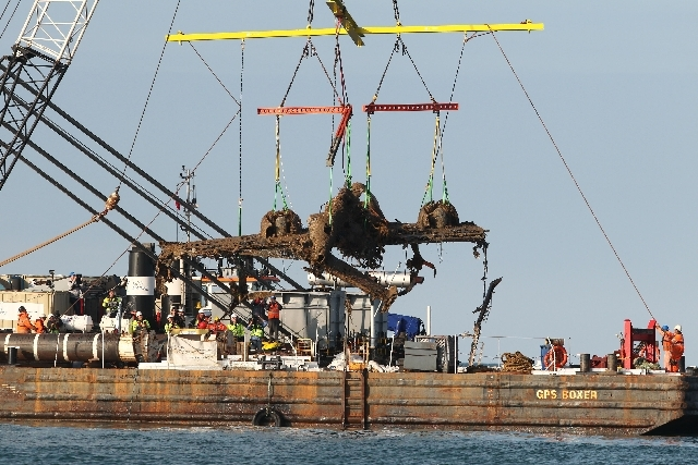 Lifting equipment raises a World War II Dornier bomber, the only surviving German Second World War Dornier Do 17 bomber, from the English Channel off Deal, southern England on Monday.