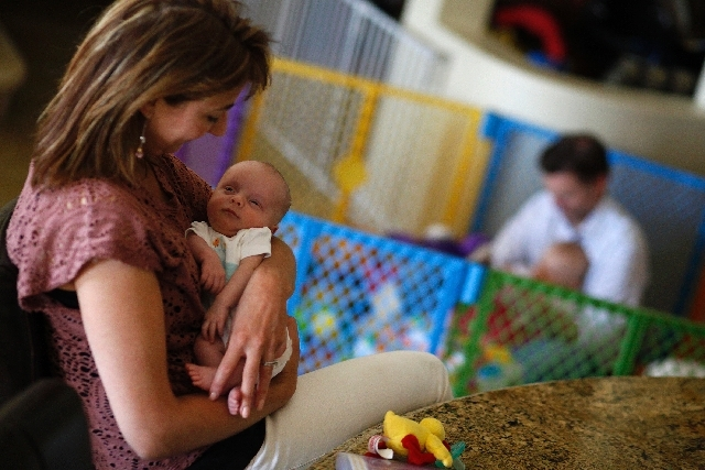 Dr. Alexandra Walsh holds 6-week-old Colin at their home. Colin, born premature, spent weeks in the hospital.