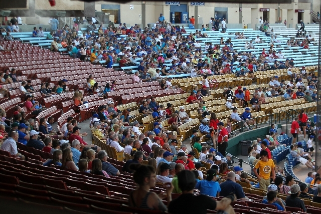 Part of the crowd of 3,937 fans watches the 51s during a 10-7 loss to the Tacoma Rainiers on Monday night at Cashman Field.