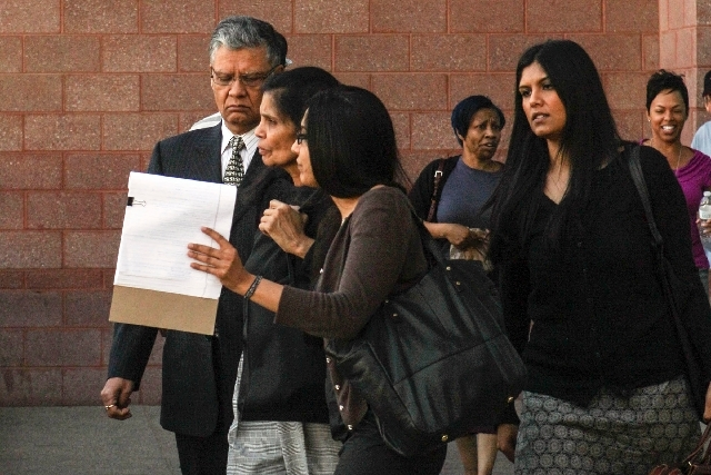 Dr. Dipak Desai leaves the Regional Justice Center with family members after his trial was adjourned for the day Monday.