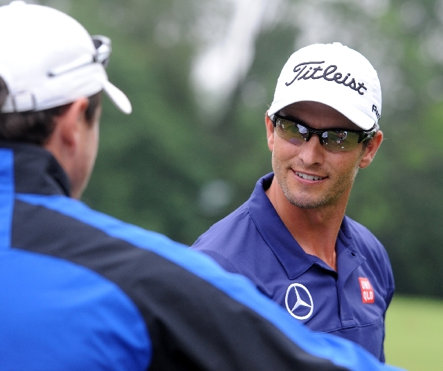Masters winner and former UNLV player Adam Scott chats on the driving range Monday during practice for the U.S. Open, which starts Thursday at Merion in Ardmore, Pa.