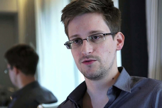 This photo provided by The Guardian Newspaper in London shows Edward Snowden, who worked as a contract employee at the National Security Agency, on Sunday in Hong Kong. The Guardian identified Sno ...