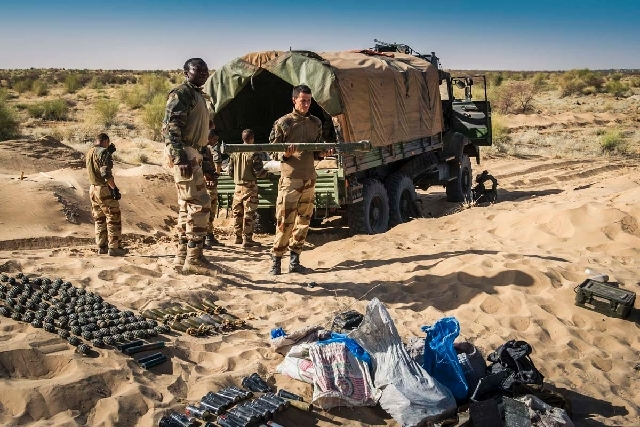 In this March 29 photo provided by the French Army's images division, ECPAD, a French soldier holds the launch tube of an SA-7 surface-to-air missile before its destruction in Timbuktu, northern Mali.