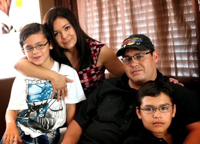 Sharon Courtney and husband James V. Courtney, a disabled veteran, are seen at home with son Darren, 8, left and son James B., 11, in North Las Vegas on Tuesday. Sharon, originally from Mexico, no ...