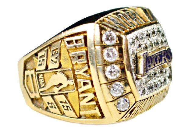 This image provided by Goldin Auctions on May 3 shows a team-issued Kobe Bryant 2000 Los Angeles Lakers championship ring given by Kobe to his father Joe Bryant. The ring is one of six items that  ...