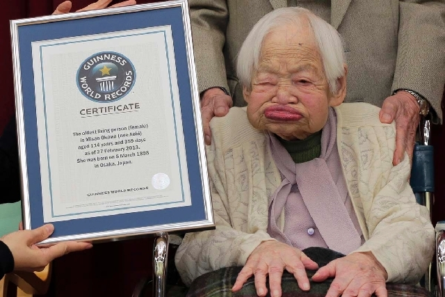 Japan's Misao Okawa, photographed on Feb. 27 when she was 114, became the oldest living person on Wednesday with the death of Jiroemon Kimura, who was 116. Okawa is now 115.