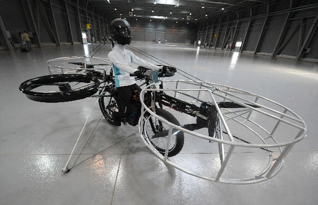 The remote-controlled Flying Bike with a test dummy is ready for its during presentation fly in Prague on Wednesday. Three Czech companies have teamed up to make a prototype of an electric bicycle ...