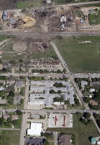 This April 18, 2013 aerial photo shows a destroyed fertilizer plant, top, following an explosion in West, Texas.  The Federal Emergency Management Agency is refusing to provide money to help rebui ...