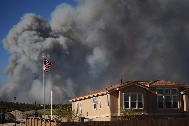 The Black Forest Fire burns northeast of Colorado Springs, Colo. The fire burned several homes and forced the evacuation of thousands of people.