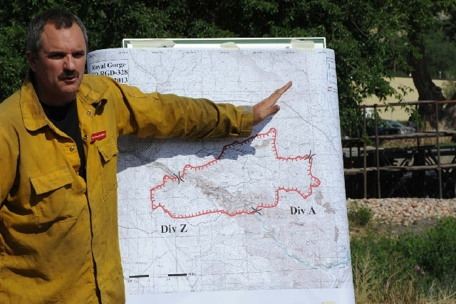 Gregg Goodland, fire information officer for the Royal Gorge Fire Department, explains the perimeter of the fire during a press conference Wednesday.
