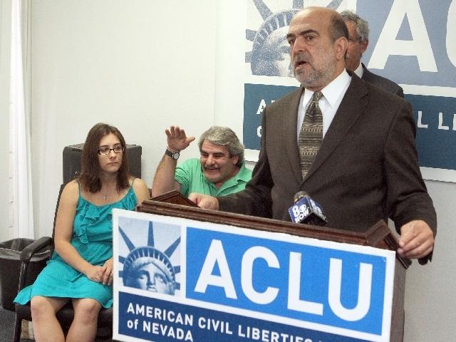 Allen Lichtenstein, general counsel for the ACLU, speaks Wednesday on behalf of James F. Brown, center, and Brown's daughter, Shotzy Harrison, left.