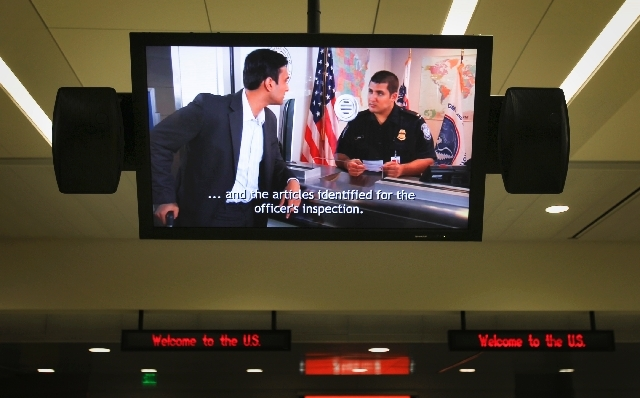 A video plays in the U.S. Customs area in Terminal 3 at McCarran International Airport in this file photo. Thus far in June, the longest wait for customs at McCarran International Airport was 67 m ...