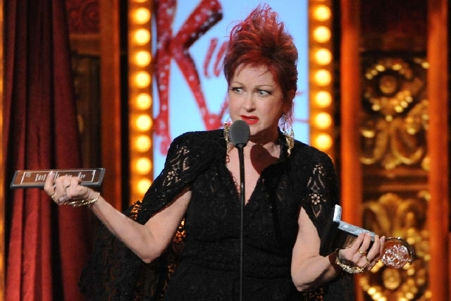 """Cyndi Lauper accepts the Tony award for best score for her work with music and lyrics in """"Kinky Boots,"""" at the 67th Annual Tony Awards on Sunday in New York. The musical is launching a national to ..."""