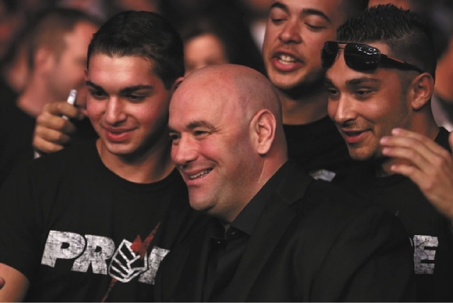 UFC President Dana White is seen with fans at UFC 159 in Newark, NJ on April 27.