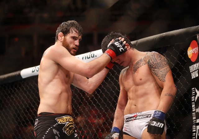 Jon Fitch, left, from of the United States, fights Erick Silva, right, from Brazil, during their welterweight mixed martial arts bout at the Ultimate Fighting Championship (UFC) 153 in Rio de Jane ...