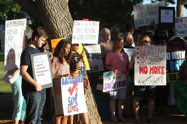Protesters Thursday at Sunset Park remember the shooting at Sandy Hook Elementary School in Newtown, Conn. They expressed ire regarding Gov. Brian Sandoval vetoing universal background checks.